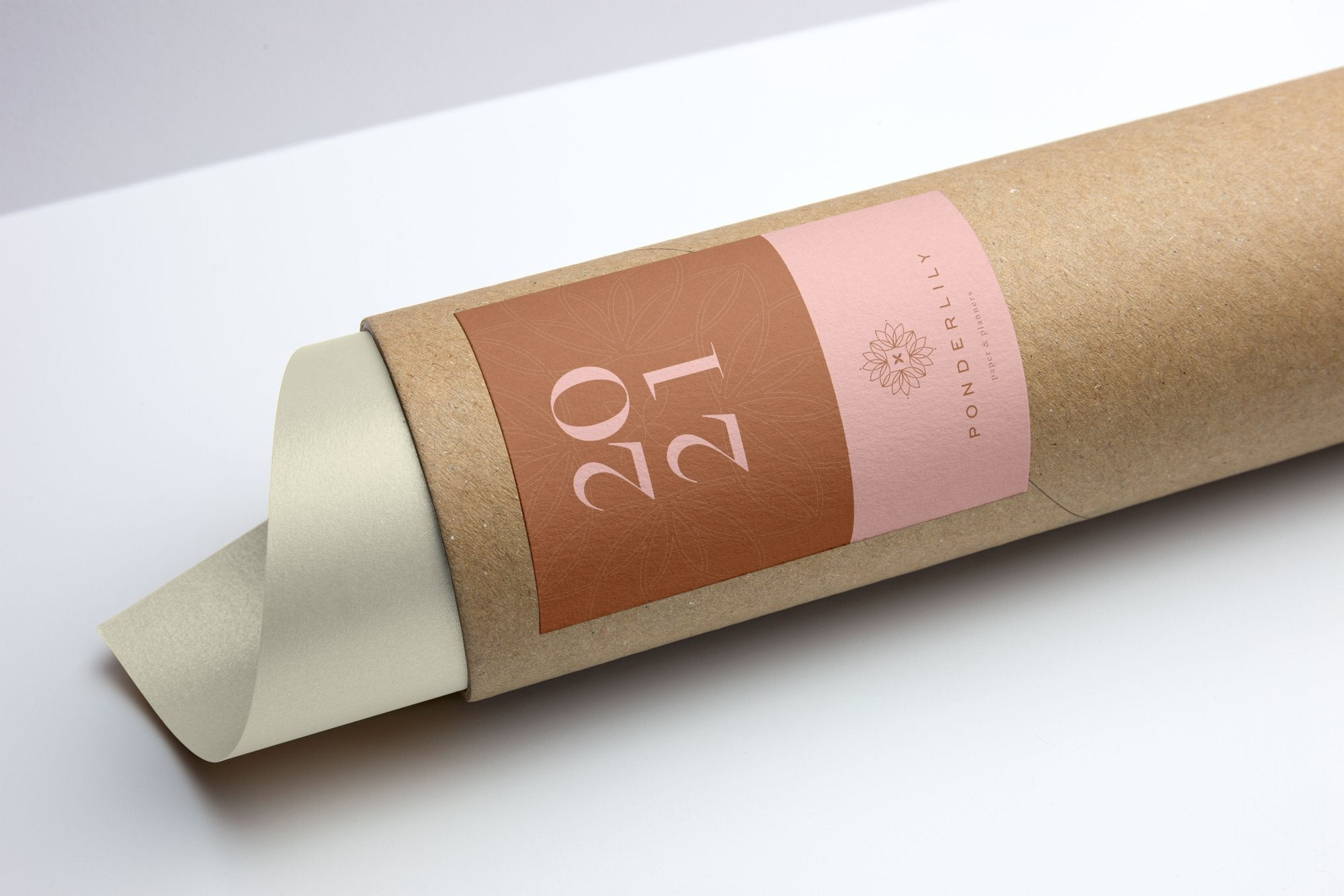 The Ponderlily 2021 Wall Planner in it's sustainable cardboard packaging tube