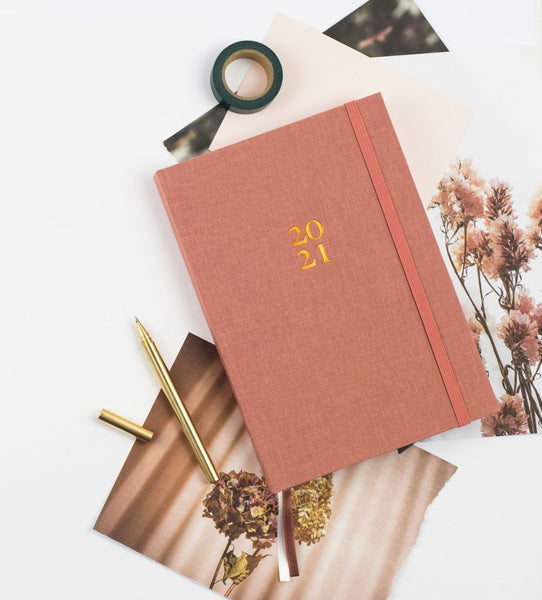 Ponderlily 2021 Planner in rose pink with images of flowers & stationery items
