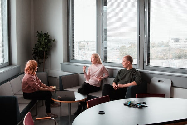 two women and a man in a meeting