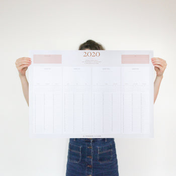 Woman holding 2020 Ponderlily wall calendar for perspective
