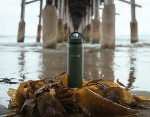 Avocado green bindle bottle at beach