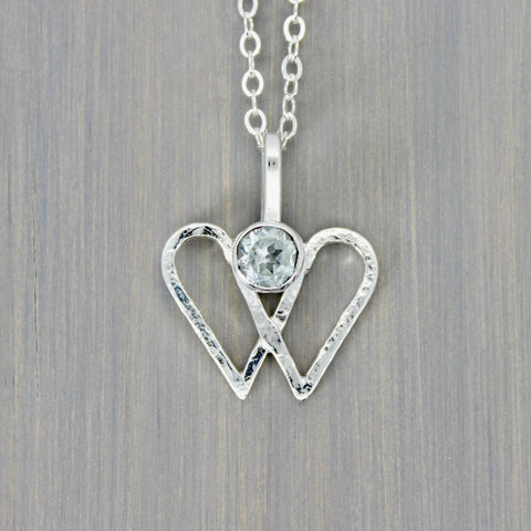 Double Heart Pendant with White Topaz