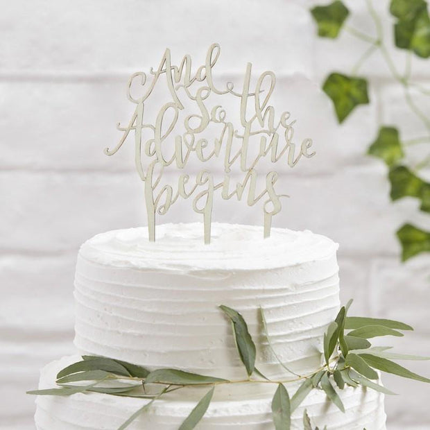 "Wooden ""And So The Adventure Begins"" Cake Topper"