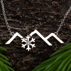 sterling silver mountain jewelry mountain necklaces, earrings and bracelets by Caligo Design