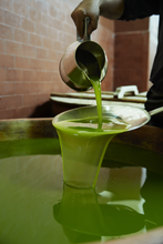 Extra Virgin Olive Oil Being Poured