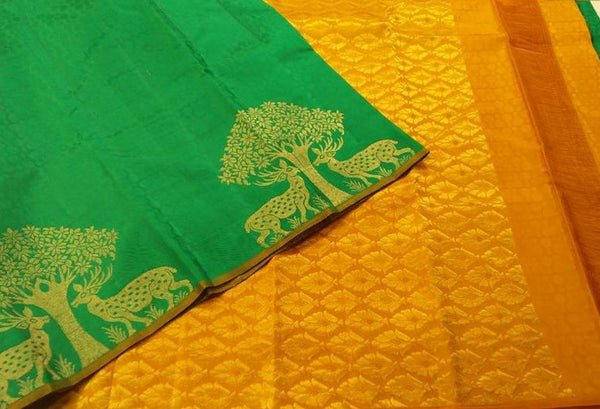 Mustard Yellow & Green with Deer with Tree Designed in Gold Soft Silk Saree