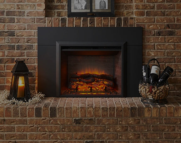 An electric fireplace is enhanced by a few decor items