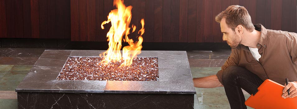 A certified professional ensures the safety and performance of a fire pit