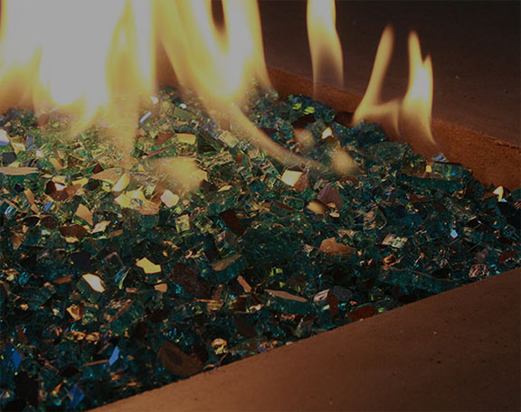 Fire glass is on display in a fire pit