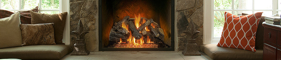 Gas logs lay in a fireplace in a living room