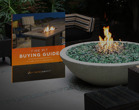 A concrete fire pit with green recycled glass sit next to a fire pit buying guide