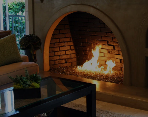 A custom fireplace hearth is ignited with stunning fire glass