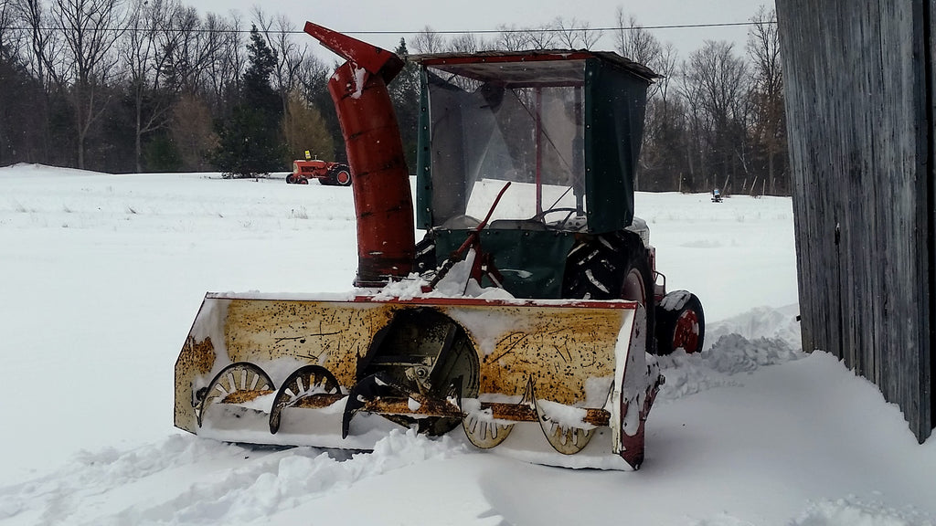 The snow blower attached to the tractor