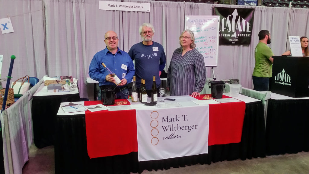 Mark T. Wiltberger Cellars Denise and Jim Toomey helping me at the Wine on Ice Festival in Elmira, NY in January