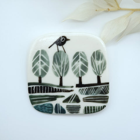 Ceramic Brooch-  Bird on a tree landscape