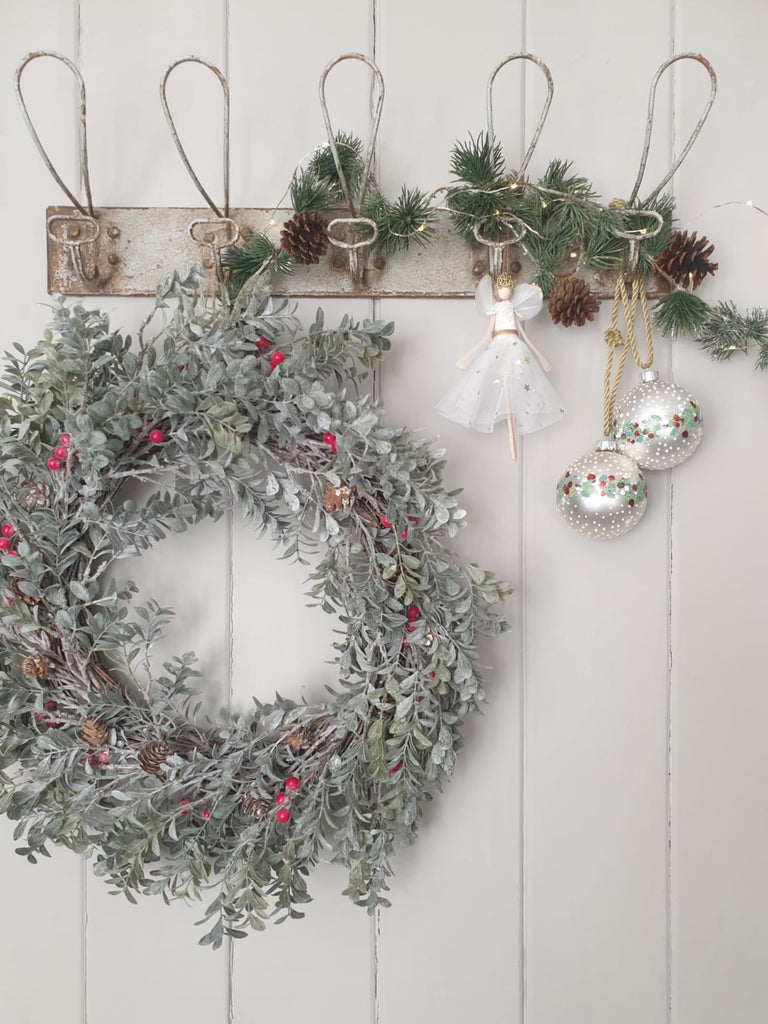 Green foliage and red berry wreath -  decoration