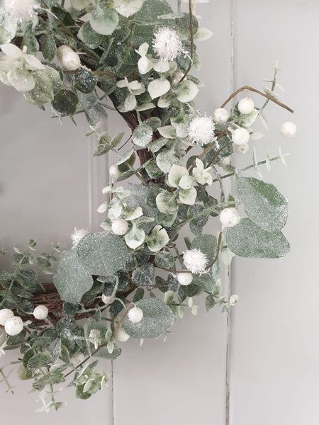 Green leaf with white berry wreath
