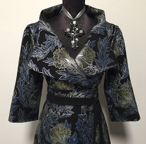 Eloise the label Nikita coat dress in a brocade in shades of blue, gree, black and silver