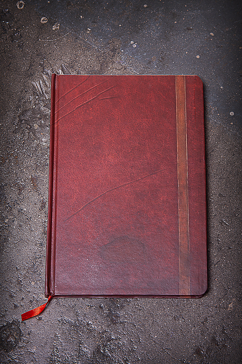 Red journal cover with bright red satin bookmark.