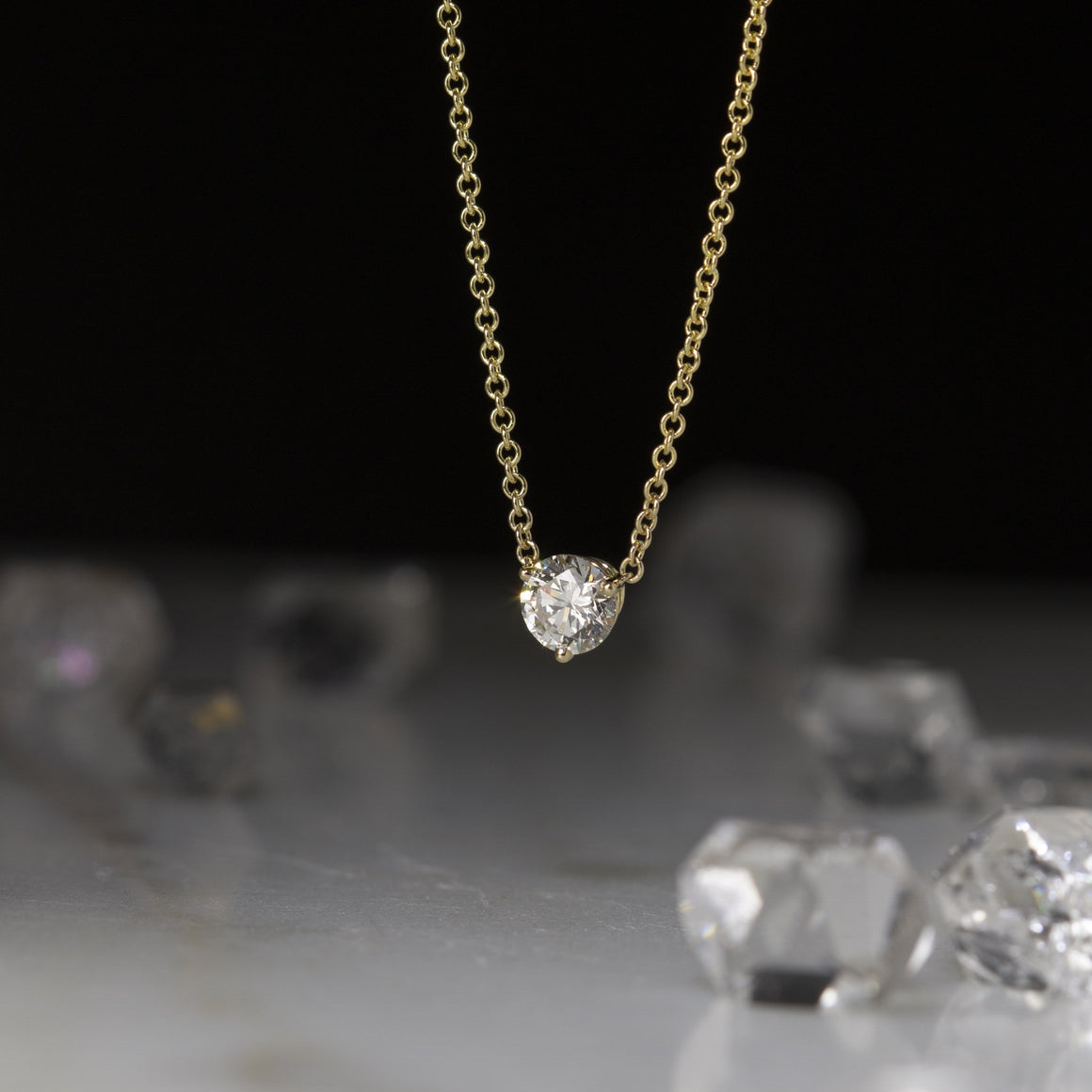 Diamond Solitaire Necklace in Yellow Gold - 1/2 carat