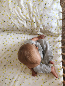 Organic petal fitted cot sheet