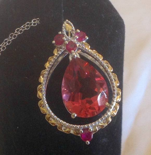 Sterling Silver Salmon Quartz Pendant with Niassa Ruby accents and Matching Earrings