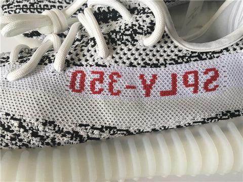 b1436a0423b2df UA ADIDAS X YEEZY BOOST 350 V2 white with white stripe and red writing