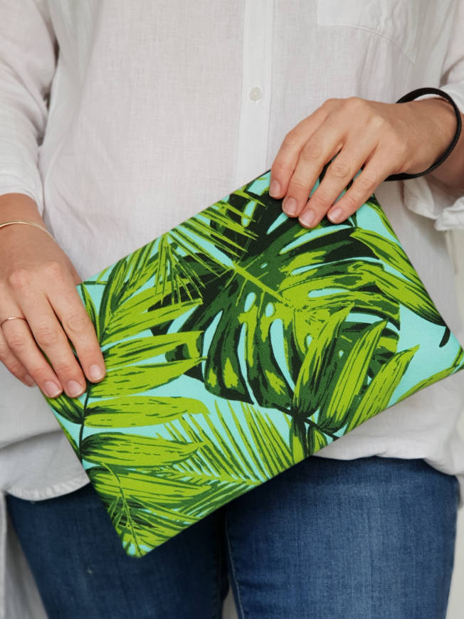 Aqua fonds fabric clutch