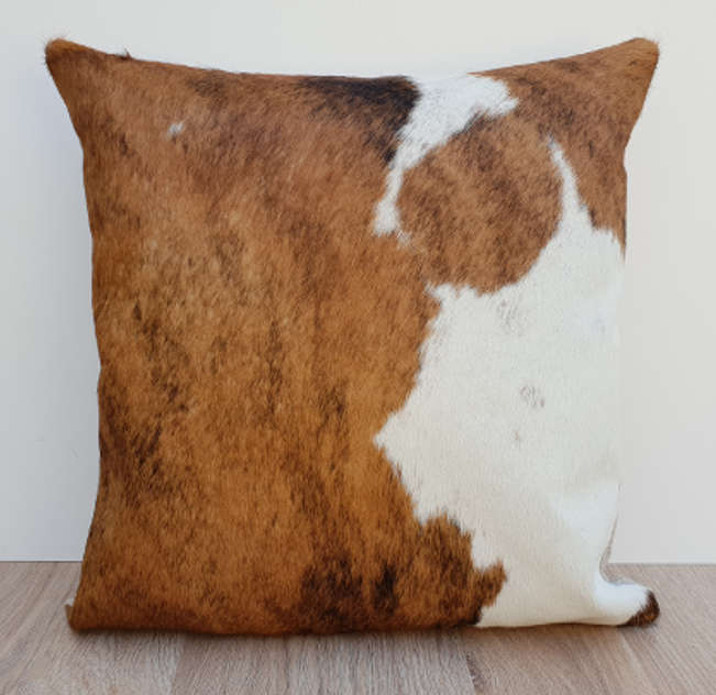 Tan Brown and white cowhide cushion