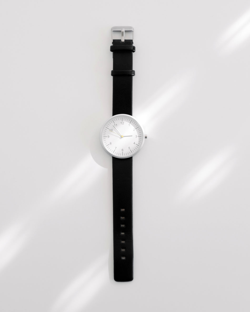 minimalist watch with leather strap