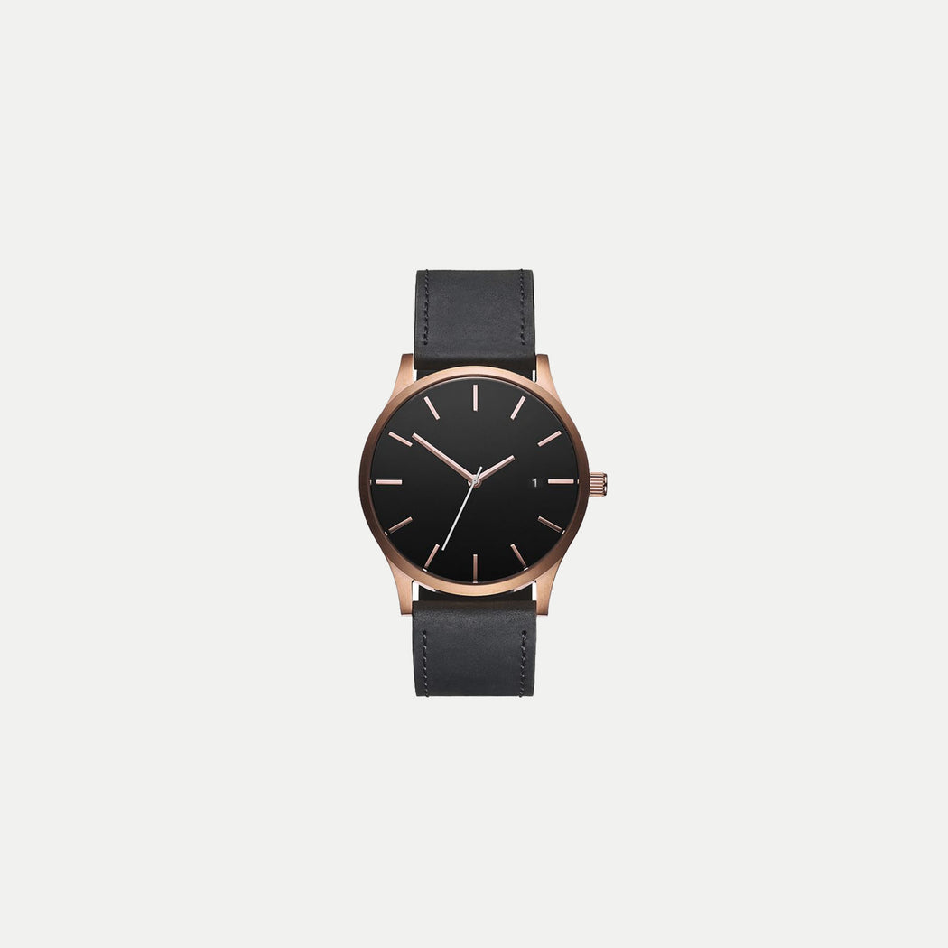 basic rose gold case watch with leather strap