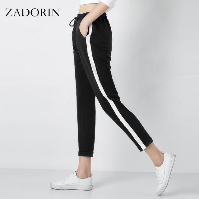 145190e93a0 ... Women Leather Striped Harem Pants Women Black Casual High Waist  Drawstring Loose Trousers Pantalon ...
