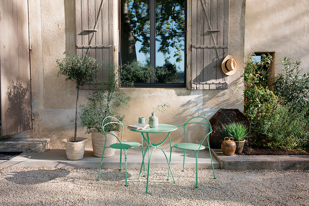 FERMOB Airloop Table and Chairs in Opaline Green. Designed by Frederic Sofia