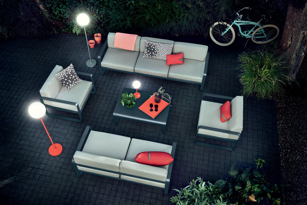 Fermob Bellevie Outdoor Lounge Chairs, Sofas and Table, with Fermob Lighting positioned by their sides