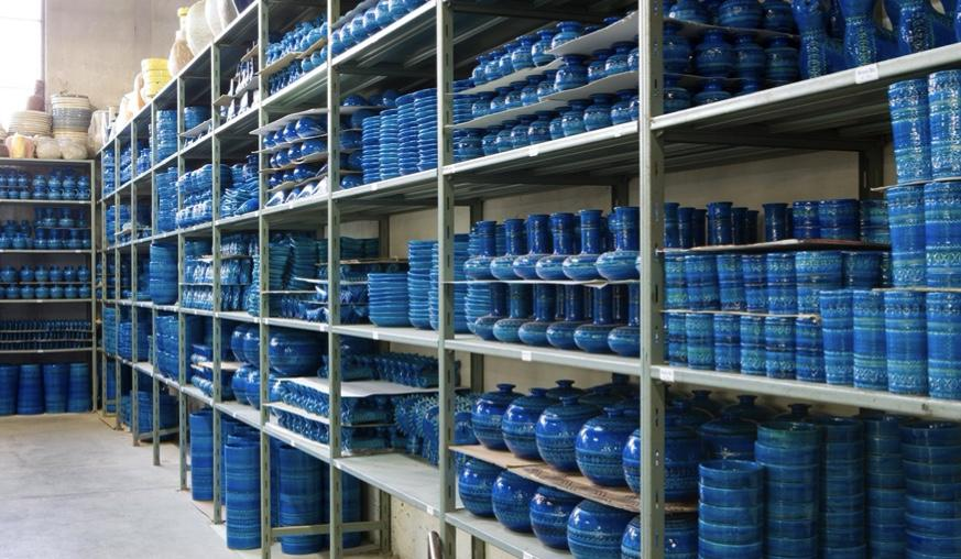 Shelves stocked high of Rimini Blu Pottery, designed by Aldo Londi and made by Bitossi Ceramiche in Italy