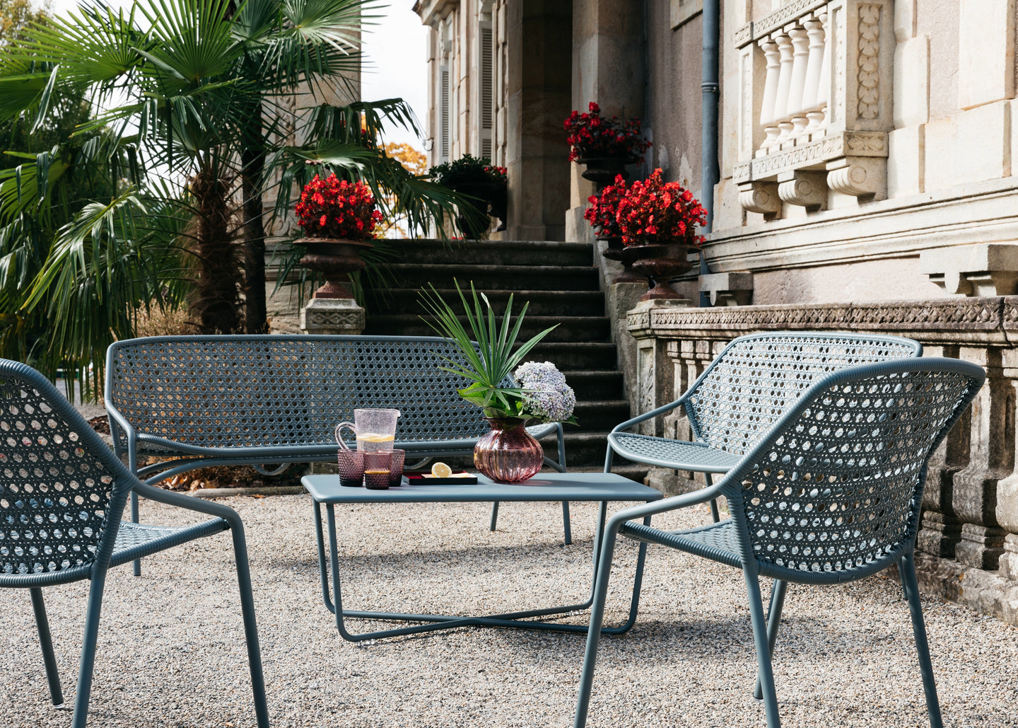FERMOB Outdoor Furniture pictured in a Southern France Courtyard.  Treacle George is very proud to be a leading UK dealer for FERMOB.  The best, made in France, outdoor furniture brand