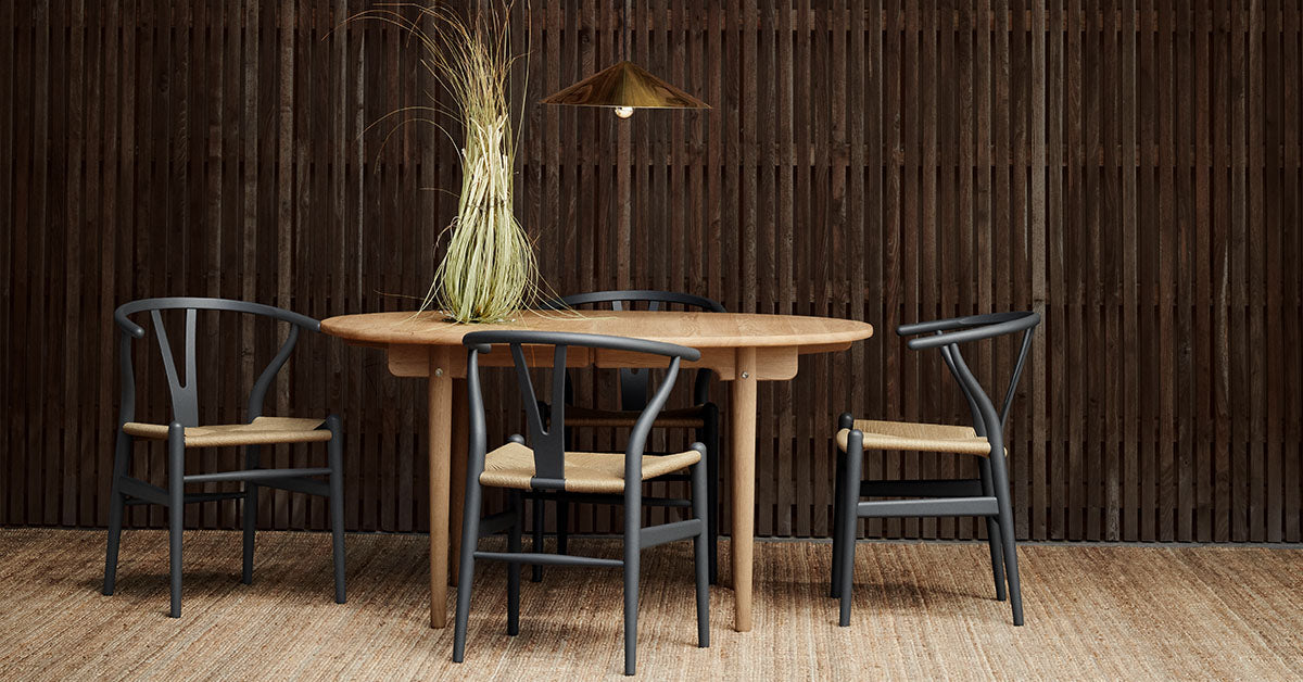 CARL HANSEN and SON Dealer. Wishbone chairs designed by Hans J Wegner pictured around a Wegner Table.  Passionate Craftsmanship, Made in Denmark