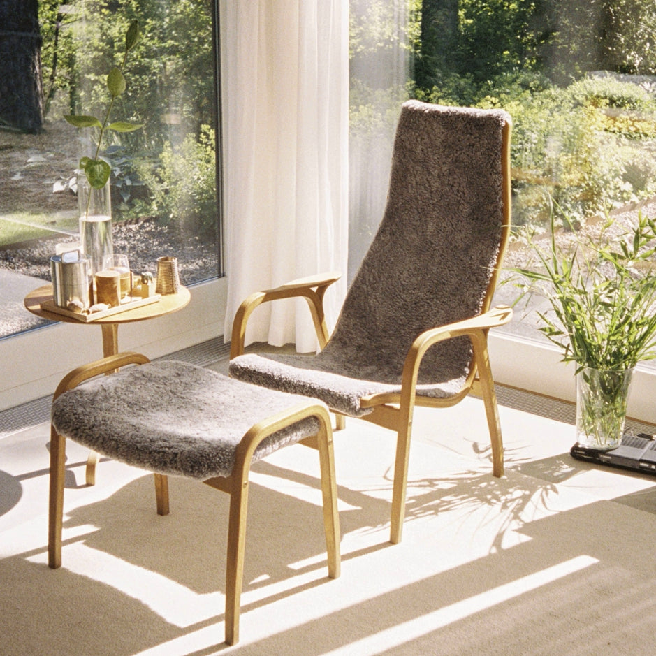 Swedese Lamino Chair with Sheepskin Upholstery in a Sunny Garden Room. We think this chair is the most comfortable chair in the world! Made in natural materials and designed with the human form in mind by Yngve Ekström in 1956
