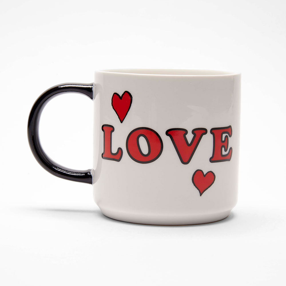 Peanuts Snoopy Love Mug in White with a Black handle and the word 'Love' written in Bold Red on one side of the Mug with two Red hearts surrounding it.
