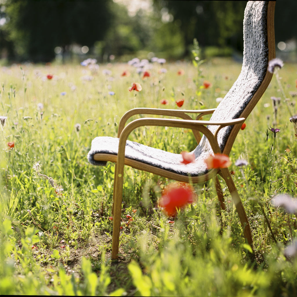 Yngve Ekstrom's Lamino Chair in a Summer field with poppies and wildflowers