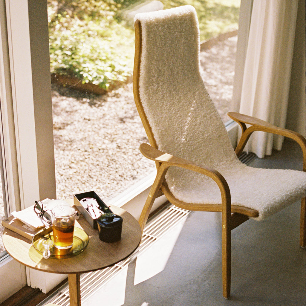 Yngve Ekstrom's Lamino Chair with White sheepskin in a sunny spot next to a Lamino table