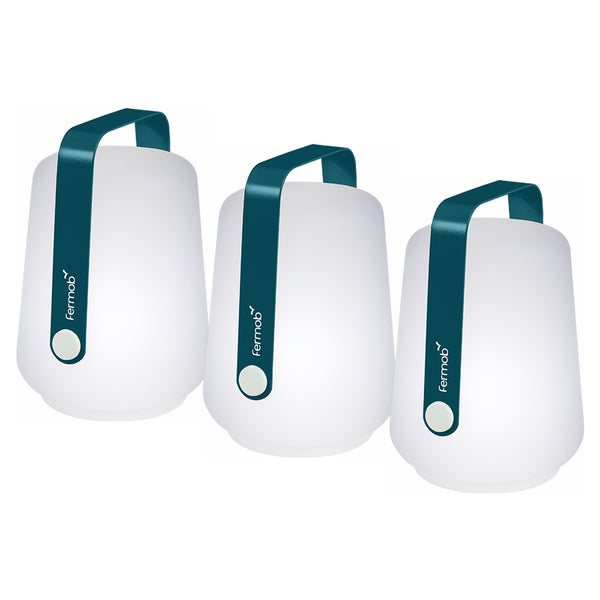 3 Fermob lanterns in Acapulco Blue on a White background. The lanterns have the Fermob logo on their metal handles.