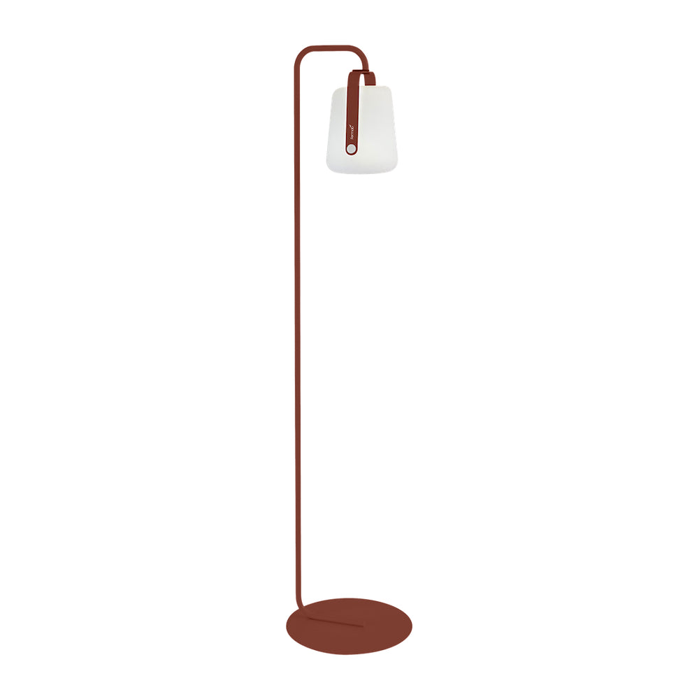 Balad Upright Stand by Fermob in Red Ochre with Fermob Lamp attached to the stand.