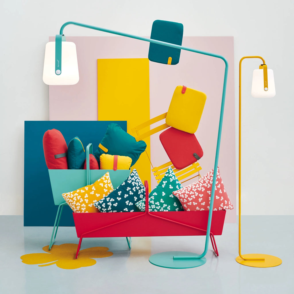 Fermob's Balad Offset Lamp in Lagoon with Balad Upright Stand in Honey in a Colourful setting with colourful pillows