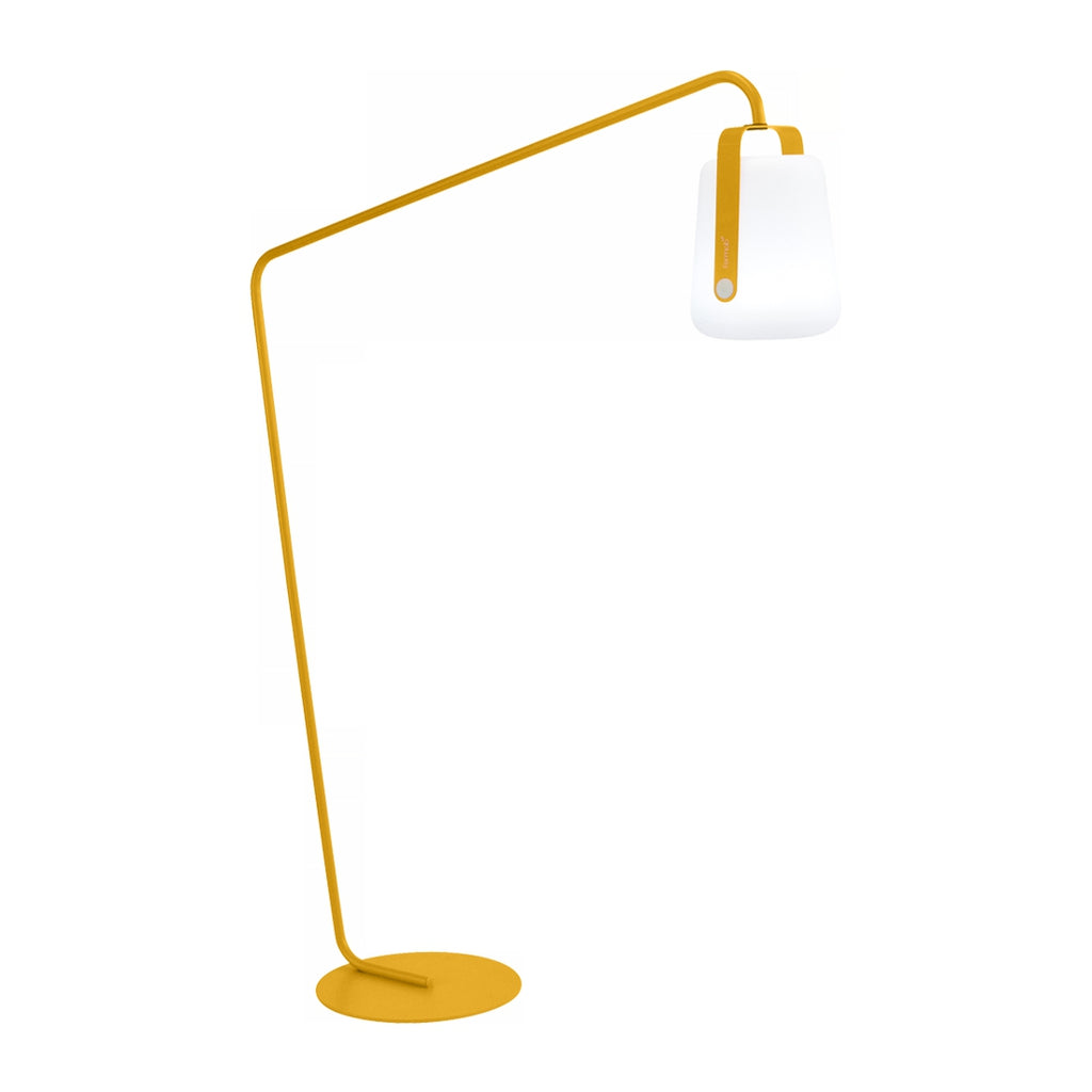 Balad Offset Stand by Fermob in Honey with Fermob Lamp attached to the stand.