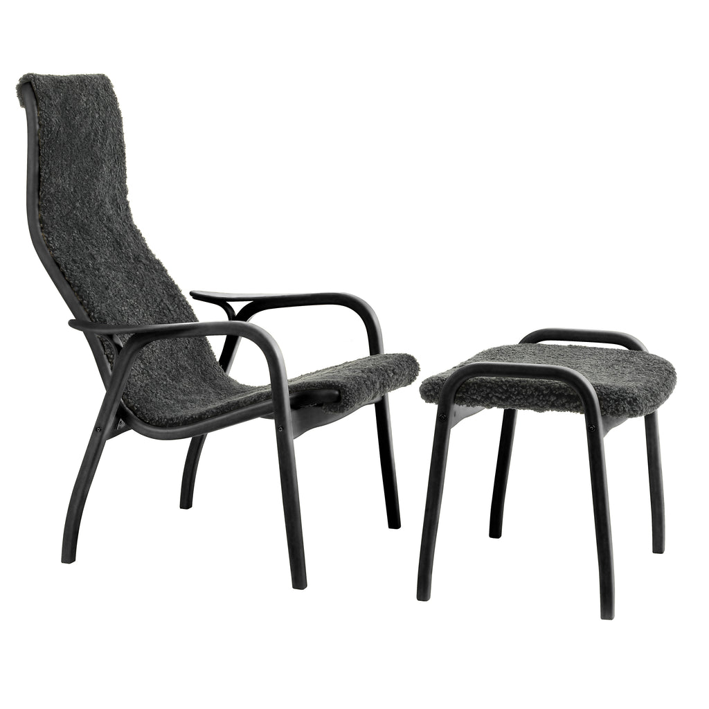 Yngve Ekstrom's Swedese Lamino Chair and footstool with Black sheepskin on a Black Oak Oiled frame