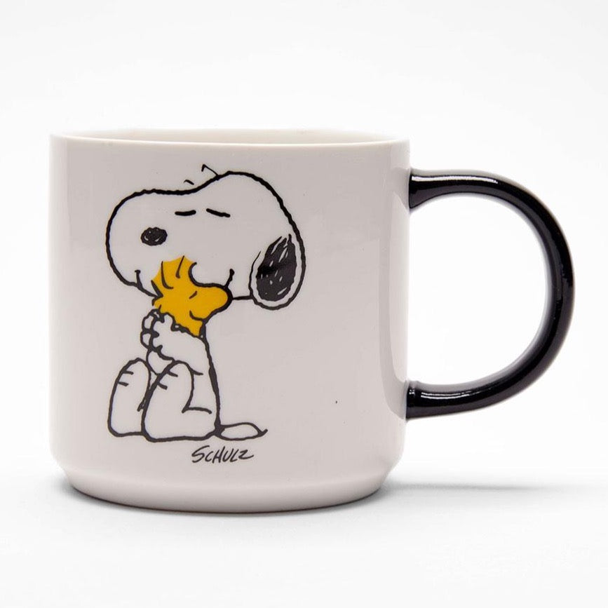 Peanuts Snoopy Love Mug in White with a Black handle and an image of Snoopy hugging Woodstock.
