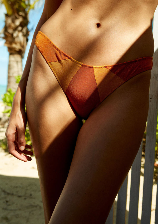 Cheeky lurex bikini bottom made from sustainable fabrics, ethically made. Sustainable swimwear brand from Barcelona.