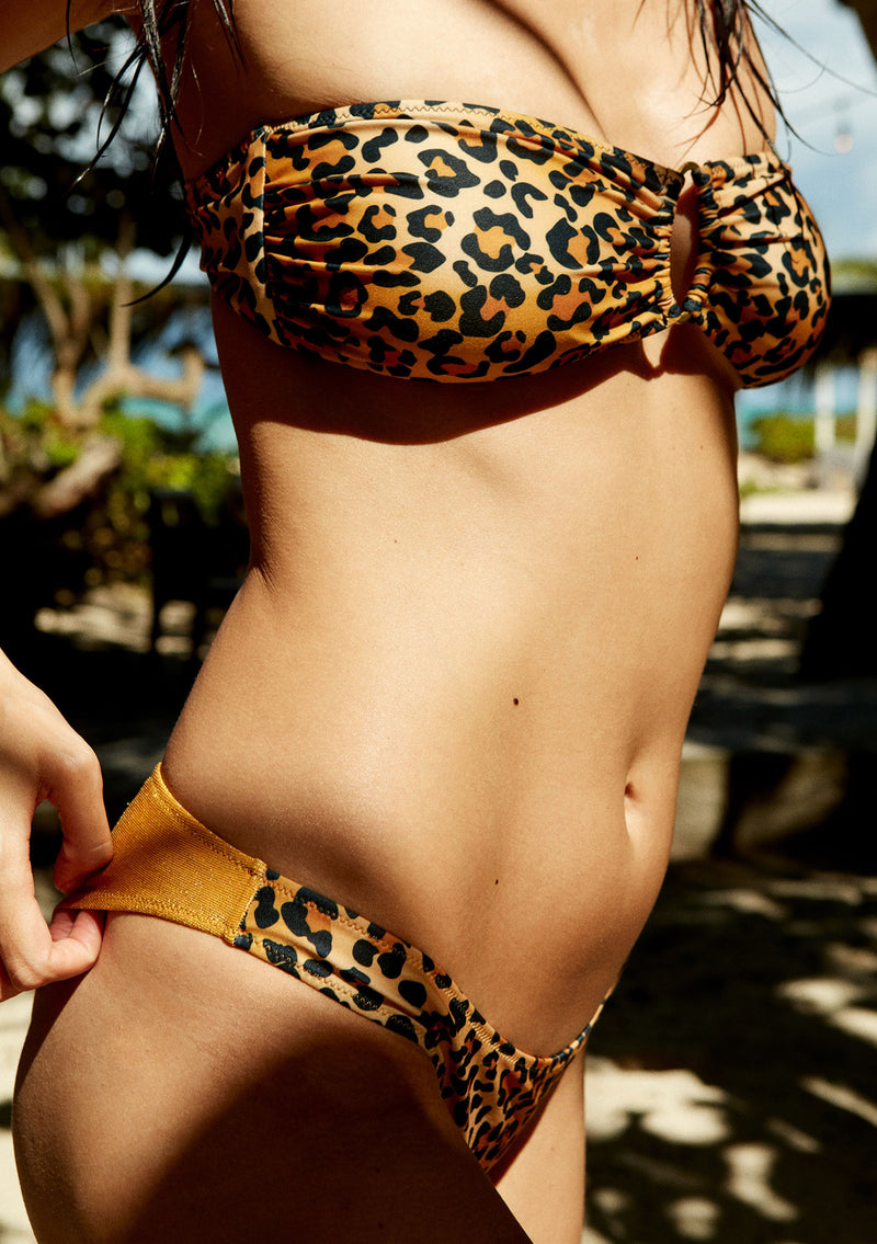 Cheeky leopard bikini bottom made from sustainable fabrics, ethically made. Sustainable swimwear brand from Barcelona.
