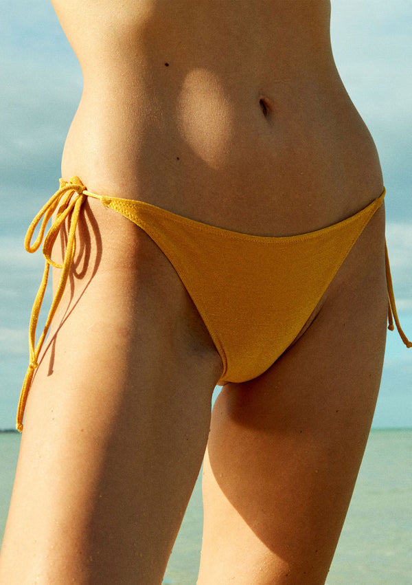 Strappy lurex bikini bottom made from sustainable fabrics, ethically made. Sustainable swimwear brand from Barcelona.